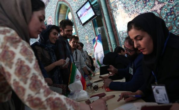 Iranians at a polling station on Friday in Tehran. Credit Behrouz Mehri/Agence France-Presse — Getty Images