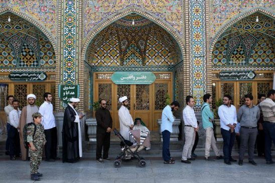 Iranians lined up on Friday in Qum to cast their ballots in municipal and presidential elections. Voting hours had to be extended. Credit Ali Shaigan/Agence France-Presse — Getty Images