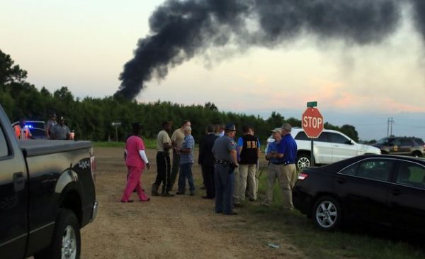 Rescue agents at the scene of the plane crash in Mississipp