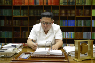 A picture released from North Korea's official Korean Central News Agency on Saturday shows President Kim Jong-un of North Korea signing documents for a test launch of an intercontinental ballistic missile. Credit Agence France-Presse — Getty Images