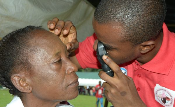 Dr. Adogbeji Stephen attending to patient