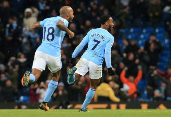 Man City restore gap, Arsenal crush Huddersfield ...